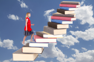 girl-climbing-book-staircase